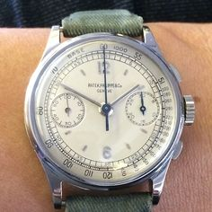 A mint stainless steel 130 with a beautiful two tone dial.  What do you think about the strap, huh?