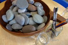 The simplicity of this loose parts activity is appealing to me. The child-sized rocks makes for straightforward play. Painting with water has the potential to encourage exploration of the properties of water.