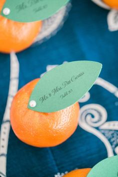 Orange place cards: http://www.stylemepretty.com/little-black-book-blog/2015/07/16/elegant-orange-navy-carlouel-yacht-club-wedding/ | Photography: Jacqui Cole - http://jacquicole.com/