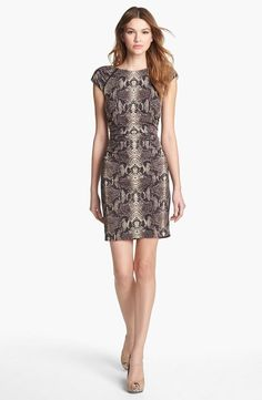 Python patterns on a flattering, ruched dress.