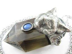 the dire wolf labradorite opal & smoky quartz by callistojewelry Crystal Pendant, Pendant Jewelry, Quartz Crystal, Survival Instinct, Dire Wolf, Grain Of Sand, Stainless Steel Chain, Smoky Quartz, Metal Working