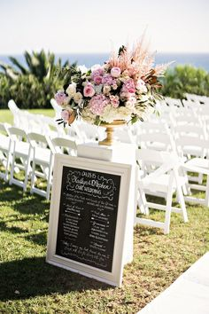 Wedding Party Blackboard Sign at Ceremony | Photography: Laurie Bailey Photography. Read More:  http://www.insideweddings.com/weddings/oceanfront-wedding-ceremony-classic-romantic-ballroom-reception/854/