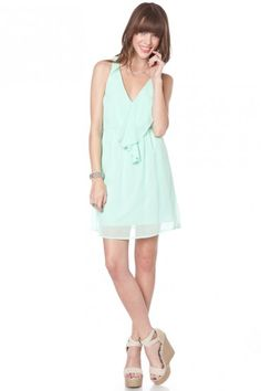 light airy ruffled racerback mini dress in a beautiful mint color for summer.  $43