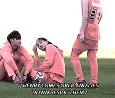 Tao and Kai looking a little confused as where Henry comes and makes himself at home