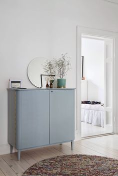 Grey cupboard sideboard sage green gold accent vase