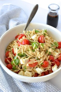 Caprese Orzo Salad - Fresh mozzarella, juicy tomatoes, garden basil and orzo pasta drizzled with a sweet balsamic syrup...perfect for lunch or a side dish!