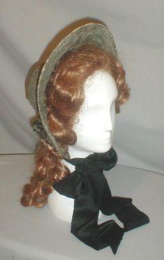 Civil War Era 1860's Black White Print Silk Bonnet | eBay seller fiddybee; brim trimmed w/ pleated ruffles, fabric laid over cane base, black satin chin ties, back curtain trimmed w/ black lace, inside lined w/ stiff buckram