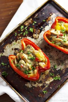 Mango Chicken Stuffed Peppers recipe- Chicken cooks in the slow cooker until tender, then stuffed in peppers and finished for a few minutes in the oven.