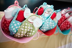 """""""bun in the oven"""" baby shower theme - bright polka dotted oven mitts as party favors"""