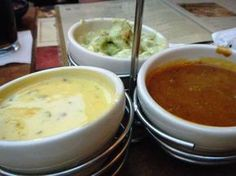 Abuelo's dip sampler which includes chile queso diablo dip, chile con queso dip, guacamole dip and salsa. All are awesome!
