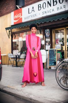 Model Ebonee Davis Talks Racism and Representation in Fashion: It was our absolute pleasure to spend an afternoon with her, dressing her in the colors of the season, and hearing all about what makes Ebonee, Ebonee. -- Long sleeve red and pink dress.  | Coveteur.com