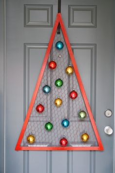 A Diamond in the Stuff: Chicken Wire Christmas Tree.  I love that this could even hang on an interior door for the kids to decorate over and over