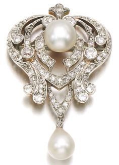 A Belle Epoque natural pearl and diamond brooch, early 20th century. Designed as an openwork scroll plaque accented with circular-cut and rose diamonds, set with natural pearls. #BelleÉpoque #brooch