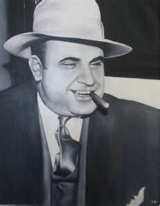 al capone in the 1920's smoking a cigar. Al Capone was a mobster in the 1920's who lived in chicago. He was wanted for Tax evasion. He got syphilis at the age of 19 and it drove him crazy to where he spent the last of his days fishing without a hook in a swimming pool.