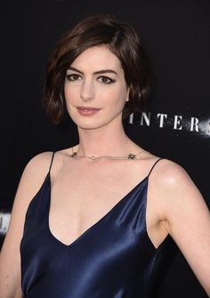 The '90s influence isn't going away anytime soon, judging by Anne Hathaway's beauty inspiration for her Interstellar premiere. Draped in a midnight-blue Richard Nicoll gown with James Bank jewelry, the actress channeled the slip-dress trend of the early '90s—with easygoing-yet-sultry hair and makeup to match. The Makeup Breakdown: To create a subtle glow, makeup artist Kate Lee first moisturized Hathaway's skin and applied Chanel's Le Blanc de Chanel illuminating base. Then, using a damp ...