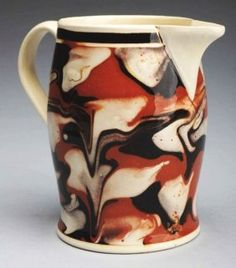 Mochaware jug with marbled slip. Britain. Early 19th Century.