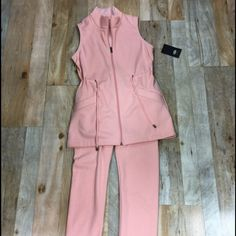"""NWT UGG pink Capri outfit Wonderful fleece sleeveless tank with matching Capris. So soft. Waist measures 32"""" and bust measures 36"""" 28"""" in length of jacket shoulder to hem. Capris are 30"""" in length and 28""""  in waist.  Offers welcome. (Reasonable please) ❌trades❌no PayPal ❌ UGG Tops"""