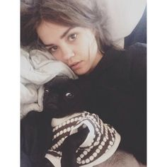 Being adorable while lying down.   20 Times Australia's Maia Mitchell Was Adorable On Instagram