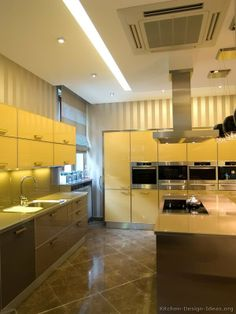 #Kitchen of the Day: Modern yellow kitchens.