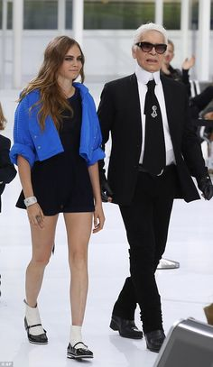 Fashion designer Karl Lagerfeld, right, with model Cara Delevingne at Chanel's Spring-Summer 2016 collection during the Paris Fashion Week in October