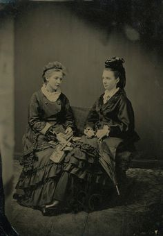 Tintype with woman holding stereocards, 1890s