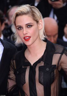 Style statement: Strategically placed pockets preserved Kristen's modesty, while she added a bold red lip to her edgy ensemble