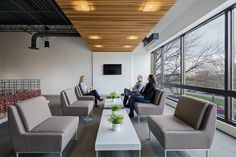 M+A Architects designed the offices of Ohio State University's Office of the Chief Information Officer, located in Columbus, Ohio. Ohio State Football, Ohio State University, American Football, Visual Merchandising, Office Lounge, Sofa, Outdoor Furniture Sets, Outdoor Decor, Design Furniture