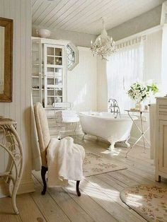 French Country bathroom with a claw foot tub