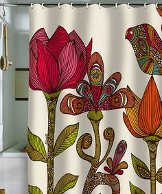 Take a look at this In the Garden Shower Curtain by DENY Designs. This would go beautifully in our guest bathroom!