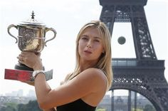 Russia's Maria Sharapova poses with the trophy in front of the Eiffel Tower, one day after defeating Romania's Simona Halep in the women's final of the French Open tennis tournament in Paris, France, Sunday, June 8, 2014. (AP Photo/Michel Euler) ▼8Jun2014AP|Maria Sharapova looks ahead to Wimbledon http://bigstory.ap.org/article/maria-sharapova-looks-ahead-wimbledon #Maria_Sharapova #French_Open #Internationaux_de_France_de_tennis #Torneo_de_Roland_Garros