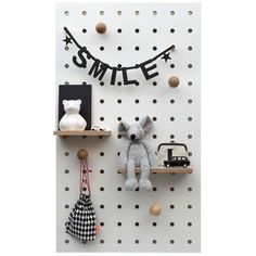 The perfect Scandinavian style storage solution for any kids bedroom, this peg board is great for organising toys, PE bags and displaying favourite knick-knacks in a fun and stylish way. Made by hand in the UK, this durable piece of furniture will adapt as kids grow up as well.