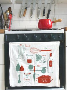 kitchen ware drawings on a towel.
