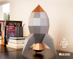 DIY papercraft retro style rocket model.  PDF template and assembly guide to build your own fabulous low poly 1930s style rocket. Great vintage design.  PDF template instant download.   Kablackout: Paper In Three Dimensions