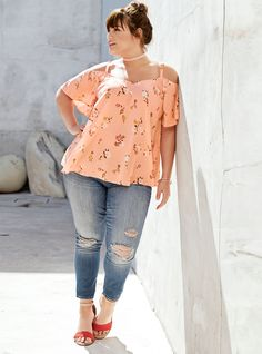 This peach pink challis top is bound-for-a-breeze with a flowy fit and cold shoulder flutter sleeves. The flit-and-float silhouette offers a feminine look with a beautiful floral print, while the strappy crossback guarantees some sex appeal.