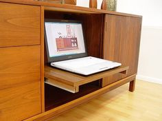 mid century mod credenza with pull out shelf.  mmm - maybe i'll add one to mine? would be very handy!