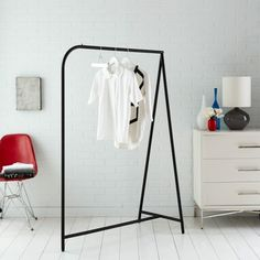 In sleek black, this garment rack is a stylish way to make use of small closet space