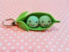 This is a cute, smiling, felt two peas in a pod key chain.  This peas in a pod key chain is designed and handmade by me! This key chain is