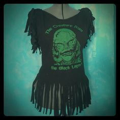 ReVamped Creature From The Black Lagoon Plus Sz T Worn once or twice. Universal Monster Tank/Tee Made from an XL men's t shirt. Fits Women's Size 20/22. Pinned back on plus size mannequin. Lace trim around neckline & a green bow on the back right side. Fringe on sleeves and hemline. All my items come from a smoke-free, clean home. Any questions, please ask. I'm on line daily. Tops Tank Tops