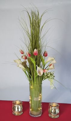 "Grass Bundle Centerpiece from LADY MADONNA'S, Yankton, South Dakota. (605-665-8842)  RENTAL PRICE (Grass Bundle, 10"" vase, Flowers, and LED lights):  $20.00  Available Quantity:  48 ."