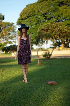 tiered dress, knee high sandals and a floppy hat for a boho-chic look