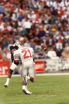 """The 1990 Hall of Fame Bowl featured Auburn vs Ohio State and """"The Hit,"""" an amazing hit from Zack Dumas on the Tigers Stacy Danley."""
