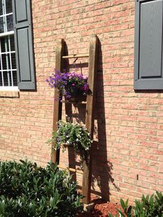 Playhouse ladder turned hanging basket flower holder.
