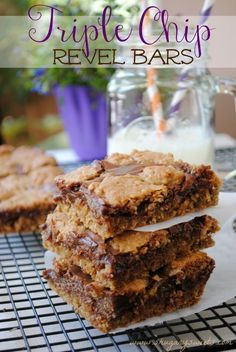 Triple Chip Revel Bars- oatmeal cookie bars filled with butterscotch, dark chocolate and milk chocolate chips! #cookiebars #dessert http://www.shugarysweets.com