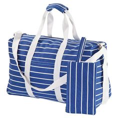 Blue and white striped canvas duffel. Product: DuffelConstruction Material: Cotton canvasColor: Blue a...