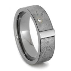 This Gibeon Meteorite ring emits a combination of strength and beauty. A bold, commanding bar of solid titanium runs perpendicular through the distinct...