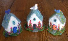 Needle felted cottage with its own garden and a bird on the roof  $60