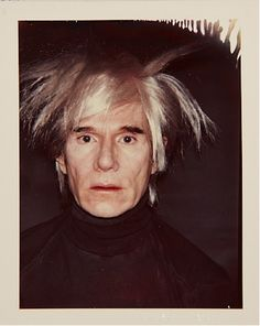 """Andy Warhol wearing his """"Fright Wig"""""""