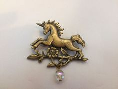 VTG. JJ JONETTE ANTIQUE GOLD TONE MYSTICAL/MAGICAL UNICORN/FLOWER CHARM BROOCH~  | eBay