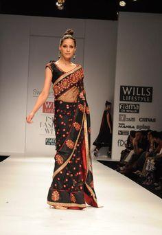 Red and black sari by Swapan & Seema