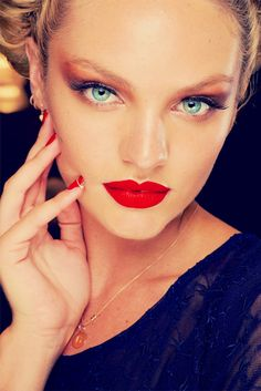 Candice Swanepoel- red eye shadow and red lips